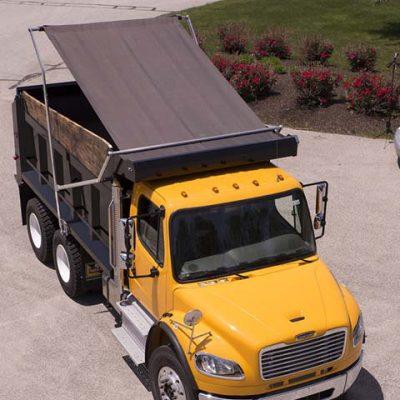 Aero Easy Cover flip tarp system on a yellow dump truck