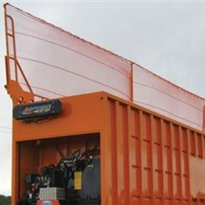 Donovan Sidewinder tarping system installed on an orange open top trailer.