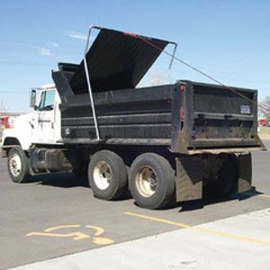 Pulltarps, pull tarp system with optional arm assembly on a dual axle dump truck.
