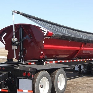 Aero Side Kick 2, Side Dump Tarping System on a Red Side Dump Trailer