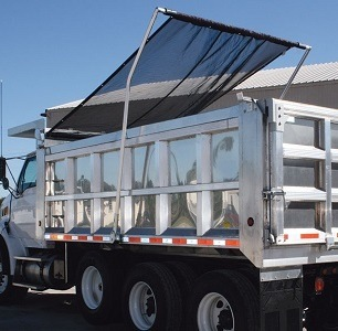 Donovan Flash electric flip tarp system on an aluminum tri-axle dump truck