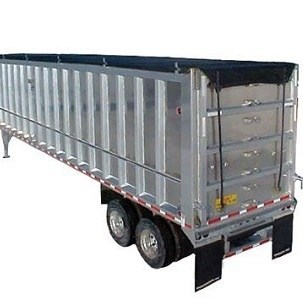 Mountain Tarp, Ratchet Side Roll with double strap rear tail secured on an aluminum transfer trailer.
