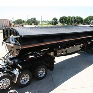 Shur-Co Iron Side Side Dump Tarp System on a Black Side Dump Trailer
