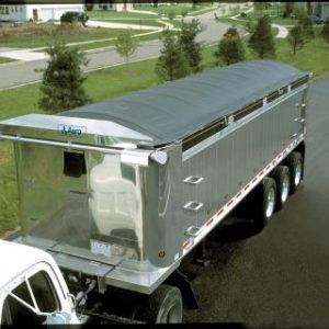 Aero, Crank-N-Go II, electric cable style tarp system installed and deployed on an aluminum dump trailer