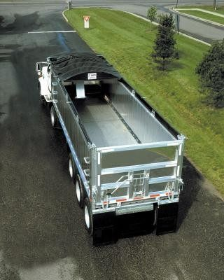 Aero, Crank-N-Go II, electric cable style tarp system installed and retracted on an aluminum dump trailer.