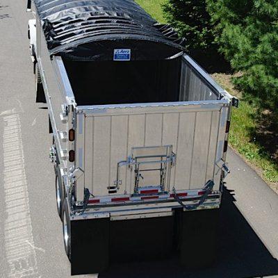 Aero, Crank-N-Go III, cable tarp system partially deployed on an aluminum dump trailer