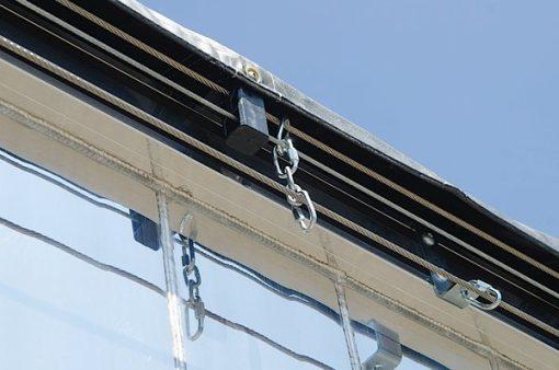Anti lift mechanism on the Aero Crank-N-Go 3 cable tarp system.