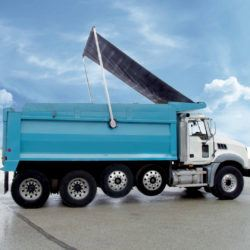Aero model 465 manual and 565 electric flip tarp system with high spring mount position on a quad axle dump truck.