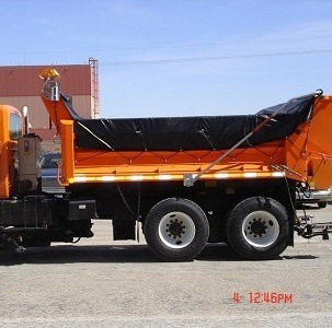Aero Easy Cover Model 550 on a DOT dump truck with vinyl tarp and side flaps deployed.