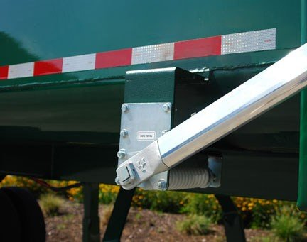 Aero Easy Cover undermount spring assembly with outrigger extensions installed on a dump trailer.