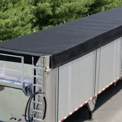 Aero ratchet style side roll system for walking floor trailers and transfer trailers up to 53' long, tarp is retracted and secured.