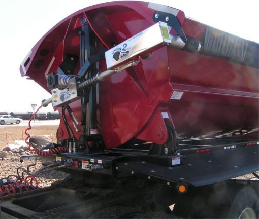 Aero Side Kick 2 side dump tarp system, front arm assembly, installed on a maroon side dump trailer.