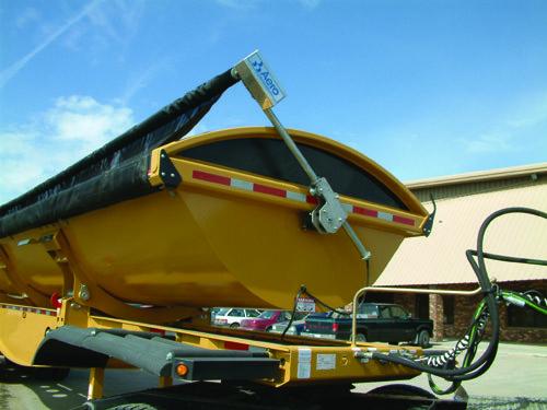 Aero Side Kick 2, side dump tarp system, front swing arm assembly on a yellow side dump trailer.