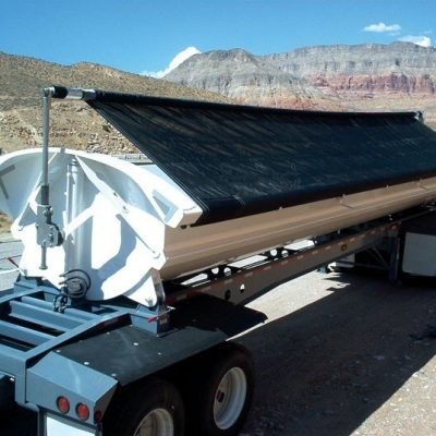 Aero Side Kick 2, side dump tarp system installed on a white side dump trailer.