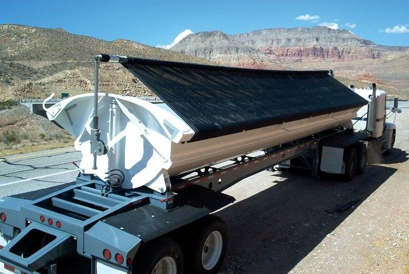 Aero Side Kick 2, side dump tarp system installed on a white side dump trailer.
