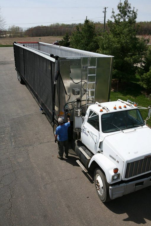 The Aero Lid 2 transfer trailer tarp system installed on an aluminum open top trailer.