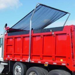Donovan Bullet electric flip tarp system mounted on a tri axle dump truck with black mesh tarp.