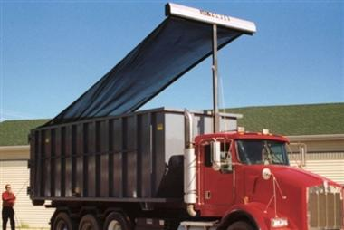 Donovan HY-Tower single leg armless tarping system with gantry elevated on a tandem axle roll off truck.