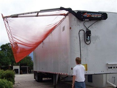 Donovan Sidwinder 350 refuse tarp system in operation on a walking floor trailer.