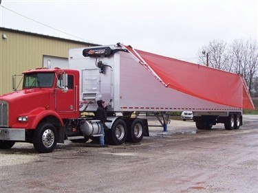 Donovan Sidewinder 350 transfer trailer tarp system in operation on an aluminum trailer.