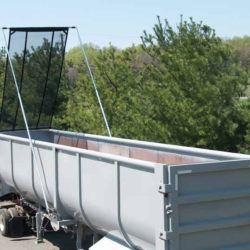 Aero Easy Cover Model 595 electric flip tarp system for scrap trailers up to 53' long, installed ona a half round trailer.