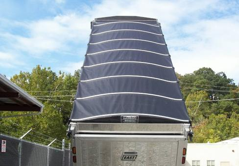 Merlot Panel Tarp System installed on a dump trailer and deployed over the load.
