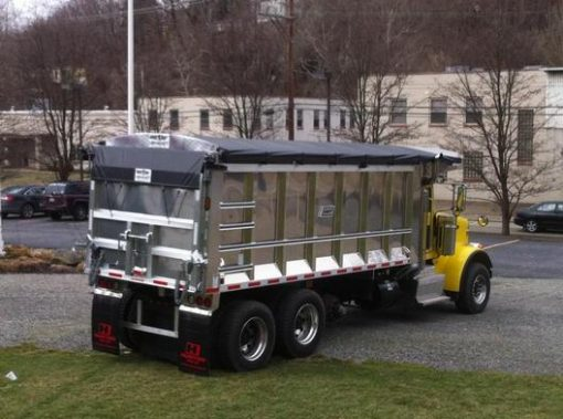 Merlot Smart Tarp cable tarp system installed on a tri axle trailer and deployed over the load.
