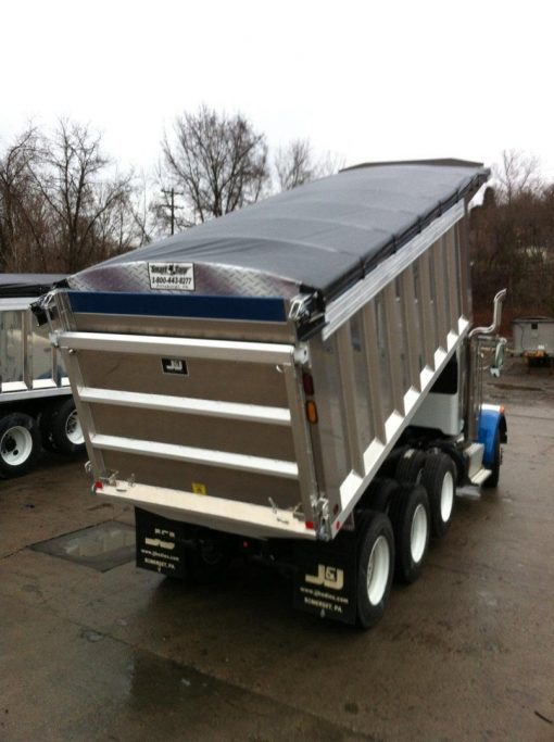 Merlot's cable style Smart Tarp system installed on a tri axle dump truck.