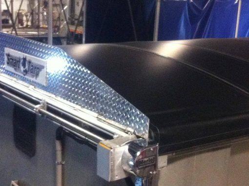 Merlot's Smart Tarp System deployed on an aluminum trailer