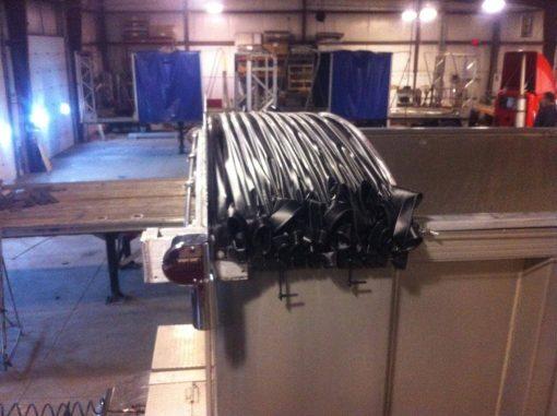 The Merlot Smart Tarp cable driven tarp system retracted on an aluinum trailer.