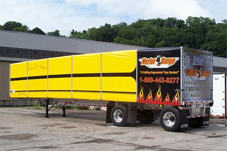 Merlot VanGo rolling tarp system on a flat bed trailer with yellow vinyl tarp panels.