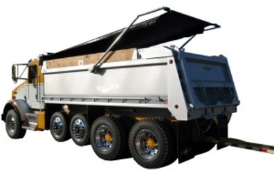 Mountain Tarp electric flip tarp system with high mount swing arms and side mount spring assemblies for pup trailers.
