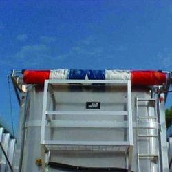 Mountain Tarp, open top trailer flip tarp system for applications up to 48 feet long with red, white and blue tarp.