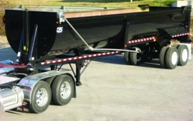 Mountain Tarp, scrap trailer electric flip tarp system with bent swing arms installed on a half round trailer.