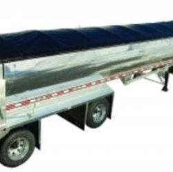Mountain Tarp side roll tarp system with a black vinyl tarp installed on an end dump trailer.