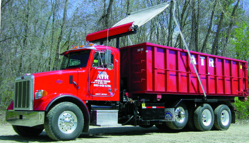 Pioneer Econocover HR1500 in operation on a tri axle roll off truck.