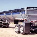 Pulltarps, Super Slider, cable tarp system with a black vinyl tarp installed on a half round scrap trailer.