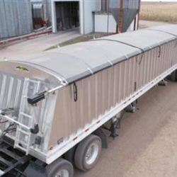 Shur Co Model 4500 electric side roll system, tarp is retracted and secured on a grain trailer.