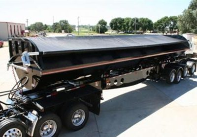 Shur Co, Iron Side side dump tarp system covering a black side dump trailer.