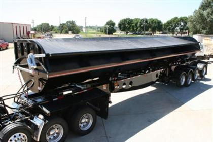 Shur Co, Iron Side side dump tarp system covering a black side dump trailer.