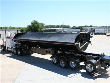 Shur Co, Iron Side side dump tarp system deployed on a black side dump trailer.