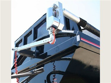 Shur Co, Iron Side side dump tarp system, front swing arm assembly on a black side dump trailer.