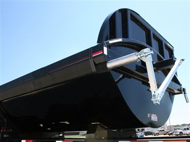 Shur Co, Iron Side side dump tarp system rear swing arm assembly on a black side dump trailer.