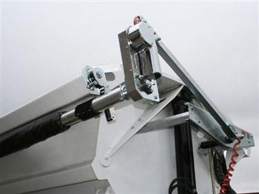 Shur Co, Iron Side side dump tarp system, front swing arm assembly on a white side dump trailer.