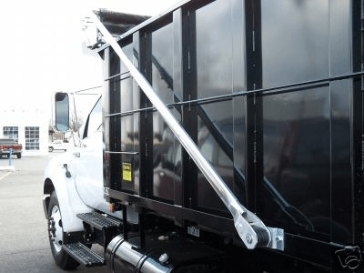 Patriot electric flip tarp system installed on a short bed dump truck with tarp retracted.