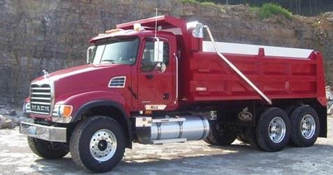 Patriot electric flip tarp system on a red tandem axle dump truck.