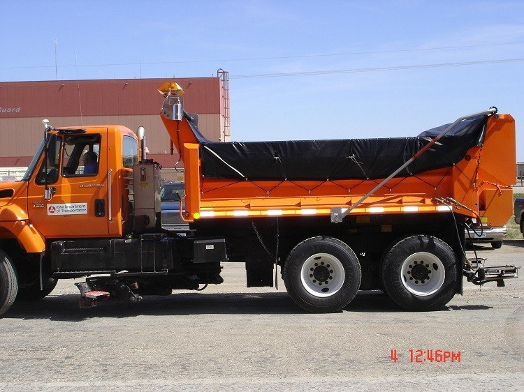 Aero Easy Cover Model 550 on an Iowa state DOT dump truck with vinyl tarp and side flaps deployed.