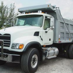 Donovan Hammer System with steel swing arms installed on tandem axle dump truck