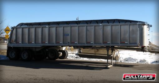 Pulltarps Top Slider with a mesh tarp installed on an aluminum trailer