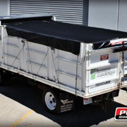 Pulltarps X-Pando semi-automatic pull style tarp system installed on a single axle box truck